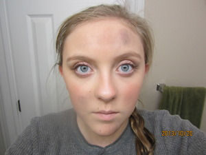 Simple natural makeup with dirt and ash because she is in the coal district.