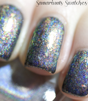 http://samariums-swatches.blogspot.com/2012/01/flakies-and-holo-galore.html