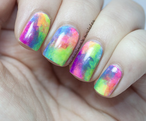 http://samariums-swatches.blogspot.com/2012/10/rainbow-sponge-icure-with-opi-black.html