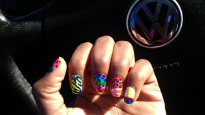 I know that I need to clean it up a little but these are my nails for the week. (:
