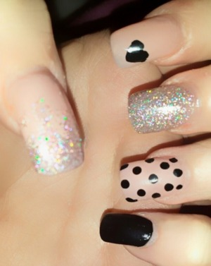 Nude, black and glitter nail designs. Different pattern on each nail