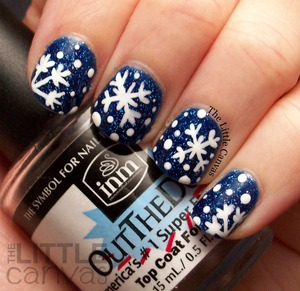 http://www.thelittlecanvas.com/2013/12/let-it-snow-snowflake-manicure-take-2.html  I used Zoya Dream and Orly Instant Artist in Pure White