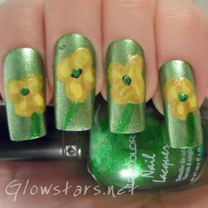 A buttercups mani created using a variety of polishes and a striping pen.