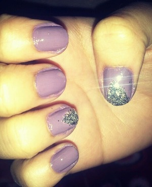 lavender nails with a triangle glitter tip!