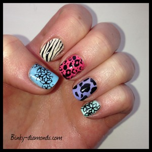 OPI Euro Central Collection with Konad animal print and flowers.