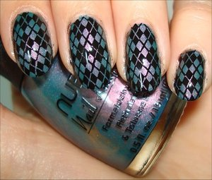 More photos here: http://www.swatchandlearn.com/nail-art-argyle-konadicure-using-nubar-indigo-illusion-konad-image-plate-m60/