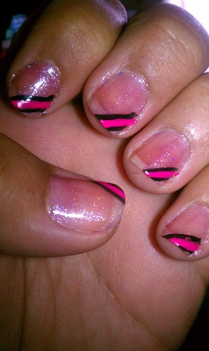 with a shier pink polish paint entire nail. with nail art polish in pink and black make a few diaginal lines then use a top coat to seal in design