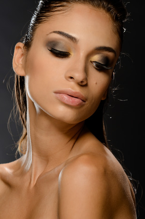 Make up : Reesie Brown Hair: Bilva Patel Model: Amanda David Soft smokey eye with gold inside eye Neutral palette, and contour for the face Tight faux hawk