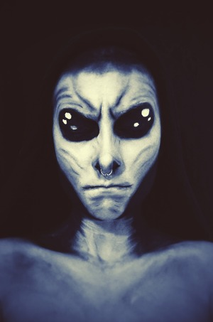 Using face paints to create basic alien look, used a black/blue filter for the finished look