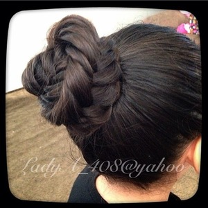 1.Put hair in a high pony tail.  2. Do a fish tail braid. *split the hair in two sections, grab a piece of hair from one side and cross it over, do the same for the other section. Continue until braid is complete* 3. Once braid is finished tie it with an elastic band. 4.Wrap braid around the hair tie. 5.Secure it with hair pins