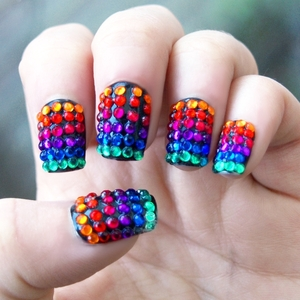 Ok so I missed Pride, but it's never too late to throw in a splash of colour so here is my interpretation of the gay pride rainbow flag! I got this awesome multicoloured rhinestone pack from an e-bay seller in Hong Kong and I decided to go with a base coat of black polish to give the colours so depth (in low light they look like that dark rainbow sheen you see in a puddle of petrol!) Hope you like 'em! GFx