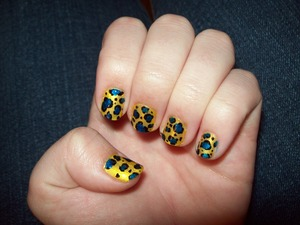 I did this for my first week of the second semester, actually, but I'm really slow with putting photos up, so... ta-da! here it is! Gold base: Sally Hansen HD Nail color- 05 Lite Blue dots: Sally Hansen Hard as Nails Xtreme Wear- 37 Blue It Black outline: Sally Hansen Nail Art Pen- 02 Black Noir