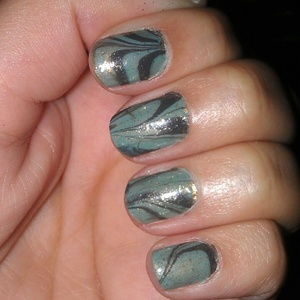 """water marble nails.  -gold base coat. -Essie """"turquoise & caicos"""" & Essie """"power clutch"""" swirls. -top coat Essie LuxeEffects """"as gold as it gets"""""""