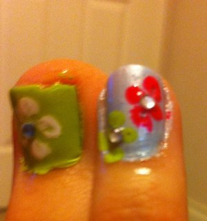 Flower on my big toe and ring finger (before I cleaned the edges)