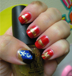 OPI Dazzled by Gold, OPI Dear Santa, China Glaze Blue Sparrow and Color Club Worth The Risque