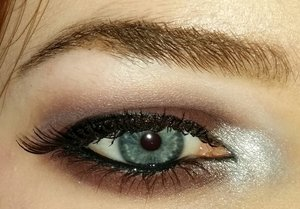 The eyeshadow is from a holiday edition Elizabeth Arden eyeshadow palette and the foundation is Mary Kay Matte-Wear Liquid Foundation in Ivory.