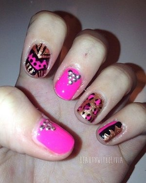 These babies would look way better if my nails were longer.. But gotta keep the designs rolling. :) I was also inspired by pinkflyingcow (YouTube channel) because she did a tutorial. Yes, I love doing tutorials :)
