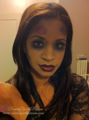 A glam zombie look for Halloween. For more information on this look you can visit my blog http://www.abeautywithbrains.com/2012/10/glam-zombie-halloween-makeup.html
