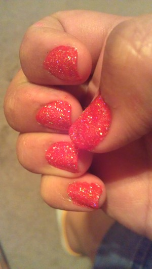 Red base with a top coat of glitter polish