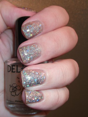 Del Sol Peek A Boo glitter sandwiched with OPI Servin Up Sparkle
