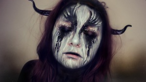 Makeup of the Zodiac is a monthly makeup series where I visualize how each sign would look like if brought to life.  This look is for Capricorn.  I used some Urban Decay eyeshadows (From Naked 2 palette) and a mixture of face paints, Mehron Clown White Lite and Wolfe FX Paint in Black.  To see the video of this transformation, click here: http://youtu.be/YeMP18WFA48