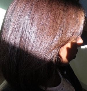 Blond in the very front, blends to light brown to reddish brown, into black at the very back.