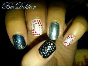 For this design I used metalic silver, aqua and black as well as a gloss red and white, then using a bobby pin i added the same size dots to all nails but one in different designs.