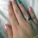 Pink pearl and teal nails