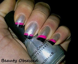 OUT OF THIS WORLD by Sinful Colors. Art Deco Nail Colors in black & hot pink for the tips.