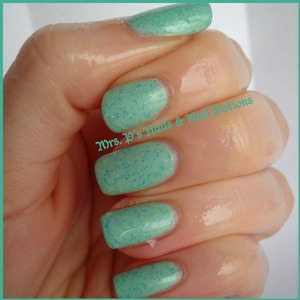"""this is a """"mood potion"""" which changes from blue to green with your body heat.  This is Caribbean Cove in it's """"hot"""" state, a seafoam green with fine holo teal glitter"""