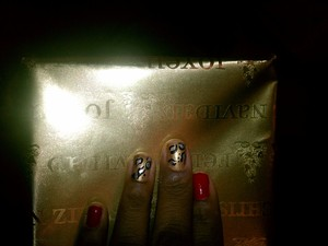 GoGo Girl by Sinful Colors (Red) Shift Power by Essie (Gold)