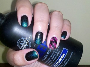 Sation Nail Lacquer in Black with a gradient using NOPI Iceberg Lotus. Accent nail was made by taping off the design, applying clear polish and a layer loose magenta glitters.