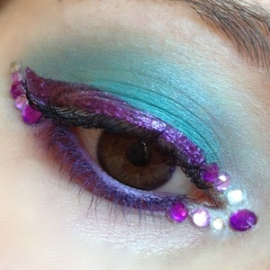 http://michtymaxx.blogspot.com.au/2012/10/turquoise-ransom.html  I wanted to fool around with my new Inglot turquoise shade and pair it with some purple, Sugarpill's Paperdoll and rhinestones and came up with this EOTD.