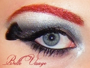 Smoky black and silver eye with a thin gel liner and feather lashes and the red brow to add some drama!