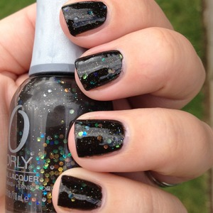 Awesome black with lots of different glitter and shimmer going on. More details at http://polishmeplease.wordpress.com