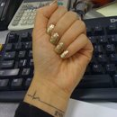 Gold glittery nails by OPI