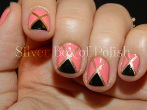 Coral, gold, and black design using striping tape.