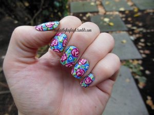 http://taupeisthenewblack.blogspot.ca/2012/09/notd-sep-2912-intricate-floral-on.html for more pics and info :)