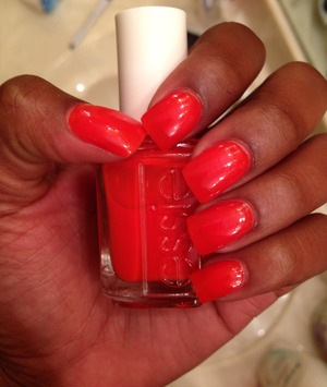Shade is called meet me at Sunset. Up close its a reddish orange.