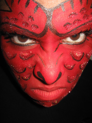 Dragon face paint done using the red from Paradise AQ 30 color Palette, black liquid eyeliner and cosmetic grade glitter. Inspired by the Wolfe brothers