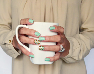 Create chevron nails for Spring!  http://www.sparkandchemistry.com/10/post/2014/03/spring-nails-gold-and-mint-chevron.html