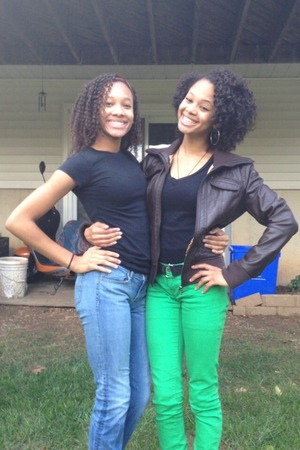 my sister rocking a braid out and me on the right with a twist out :)
