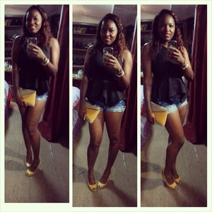 lucky brand shorts with a simple black top with splash of yellow. clutch was a gift and shoes from thrift store
