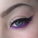 Simple winged liner with pop of colour.
