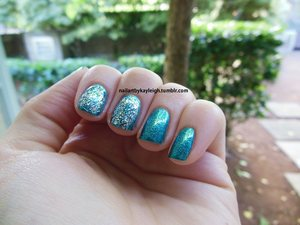 Maybe not exactly cocktail nails, I think I'd need to paint the thumb glittery too... whatevs! LOL This is several layers of teals (including my newish Essence Choose Me! which I hadn't used yet, that's it on the ring and pinky fingers! So pretty) and LA Girl Glitter Addict in Explosion on the index and middle fingers.