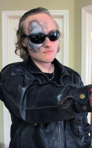 Terminator makeup with burnt skin prosthetic.