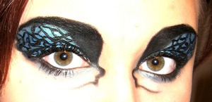 Shockingly, NOT inspired by Black Swan. It's cool that it look like it is though.lol. :)