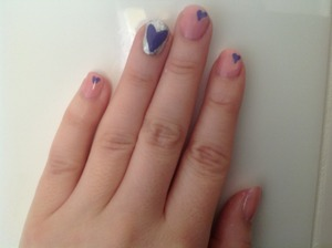 Baby pink nails with purple hear detail
