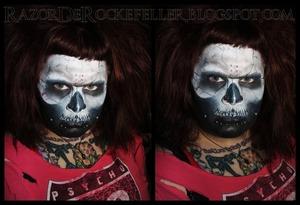 Full face skeleton makeup.