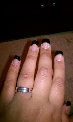 Acrylic nails with a black french tip